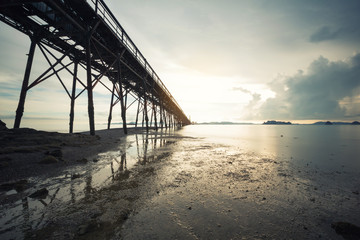 beach with bridge in long exposure