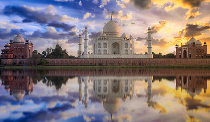 Fototapete - Taj Mahal sunset view from Mehtab Bagh on the banks of Yamuna river. Taj Mahal is a white marble mausoleum designated as a UNESCO World heritage site at Agra, India.