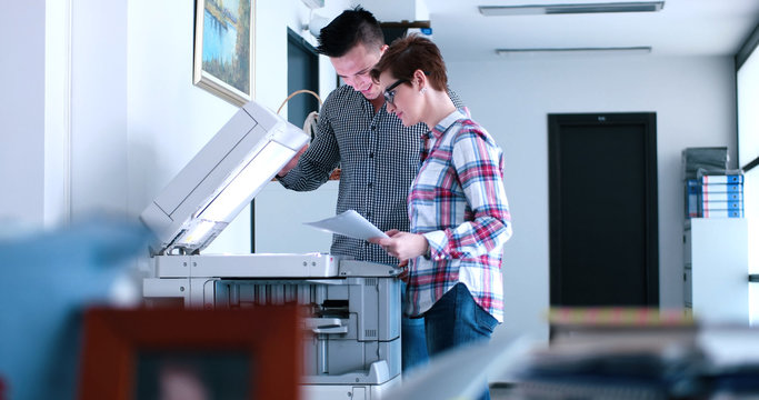 businesswoman with her assistant making copies of files