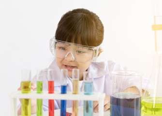 Asian child playing scientist with colorful lab tubes