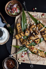 Pork satay served with peanut sauce or sweet and sour sauce.