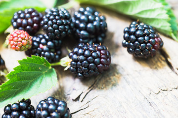 Fresh blackberry on a wooden background