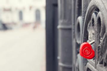 Red heart shaped lock on grey bridge. Love concept