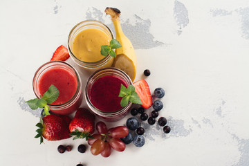 Bright summer smoothies in glass jars