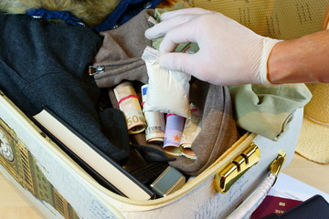 Suitcase with money and drugs on custom inspection