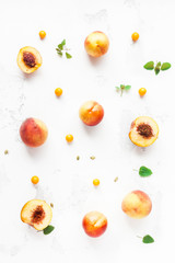 Fresh peaches. Sliced peaches and physalis on white background. Flat lay, top view