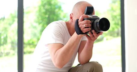 Photographer takes pictures with DSLR camera