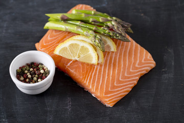 salmon fillet, lemon, asparagus and spices
