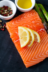 salmon fillet, lemon, asparagus and spices