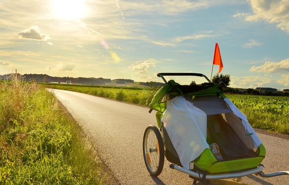 Child cycle trail riding on the bicycle path in beautiful countryside before sunset.