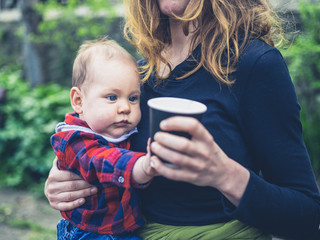 Baby grabbing paper cup