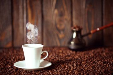 Strong coffee on the wooden background. Fresh coffee.