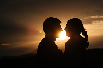 Love couple on sunset at nature