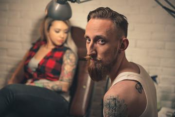 Man working in tattoo salon