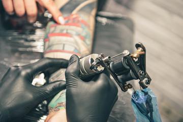 Man painting image on arm of female