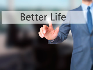 Better Life - Businessman hand pressing button on touch screen interface.