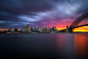Wall Mural - Sunset skyline of Sydney downtown  with Harbour Bridge, NSW, Australia