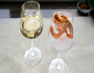 Shrimps on ice in glass