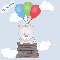 Greeting card the bear cub flies in a basket tied to balloons.