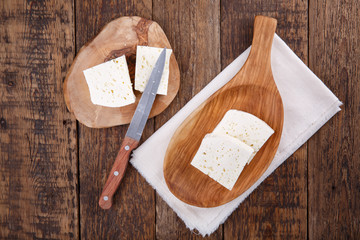 Sliced fresh brined white cheese from cow milk