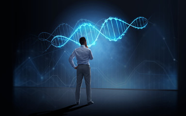 businessman looking at virtual dna molecule