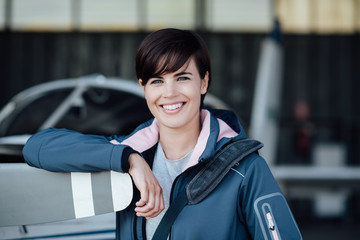 Confident female pilot in the hangar