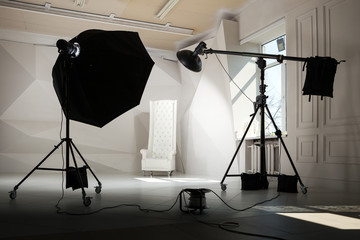 commercial photo studio interior vith professional light eqipment.