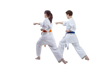 Girls are training punch hand against a white background