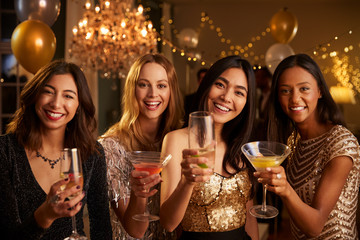 Female Friends Celebrating At Party Make Toast To Camera