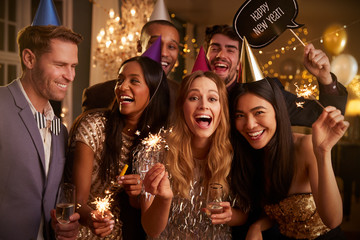 Group Of Friends Celebrating At New Year Party Together