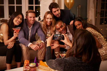 Friends Posing For Photo As They Have Fun At Party Together