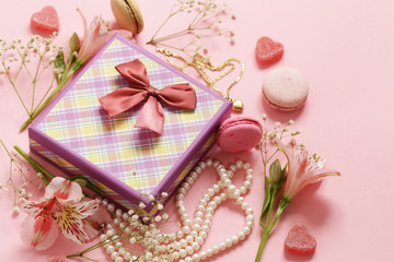 Gift box with jewelry, flowers and macaroons