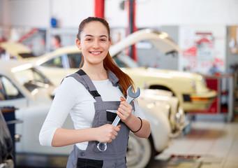 Female apprentice in car service station