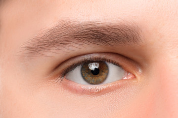 Beautiful brown man eye close up