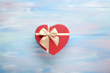 Beautiful heart gift box on a blue wooden table