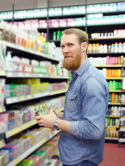 man choosing products for body care