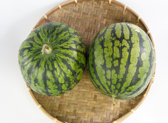watermelon on a bamboo basket isolated on white background
