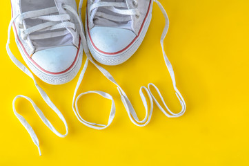 now, message on shoelace with sneakers.
