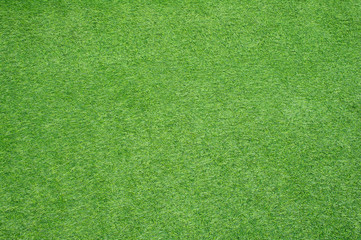 Soft focused picture of walkways cover by green artificial