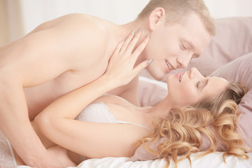 Couple having sex in bedroom