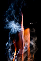 Close up view of natural flame with smoke