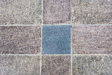 Colored stone street pavement texture.