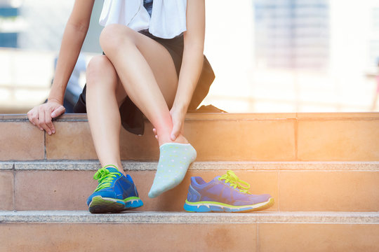 Athlete woman tying running shoes getting ready for jogging