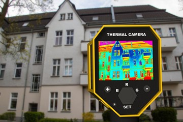 infrared thermal imager showing building facade and window heat loss