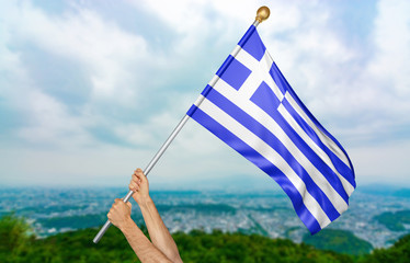 Young man's hands proudly waving the Greece national flag in the sky, part 3D rendering