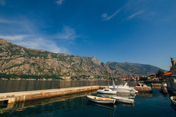 Boka-Bay mountains and boats marina in Montenegro, Kotor Bay