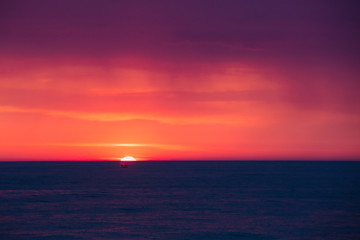 Natural Purple Color Sunset Or Sunrise Sky Over Sea After Storm