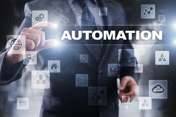 Businessman selecting automation on virtual screen.