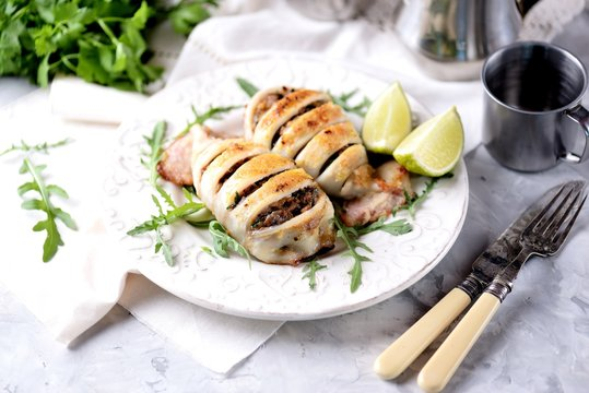 Baked squid stuffed with onions, carrots and mushrooms