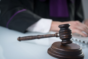 justice and law concept.  judge in a courtroom with the gavel,